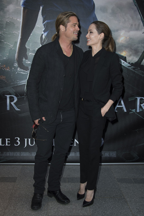 "World War Z - Paris Premiere - Red Carpet Arrivals - PARIS, FRANCE - JUNE 03:  Brad Pitt and Angelina Jolie pose as they arrive for the Paris premiere of ""World War Z"" at Cinema UGC Normandie on June 3, 2013 in Paris, France.  (Photo by Pascal Le Segretain/Getty Images For Paramount)"