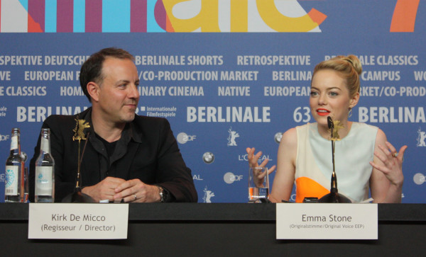 Emma Stone and director Kirk de Micco at the Berlinale, presenting The Croods