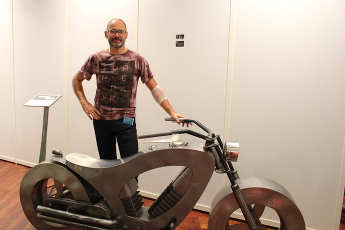 Eric Faure with his bike at Art International - credit photo Veronique Gray