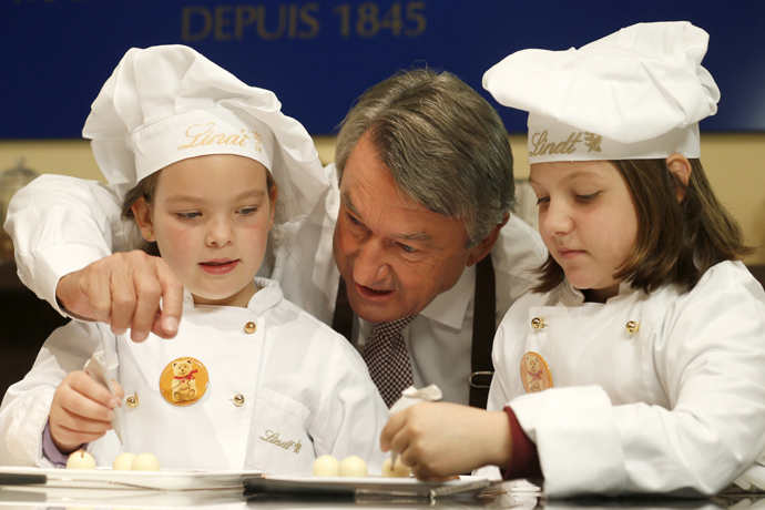 Ernst Tanner with the children making Lindt chocolates in Kilchberg headquarters - credit Photopress Alexandra Wey