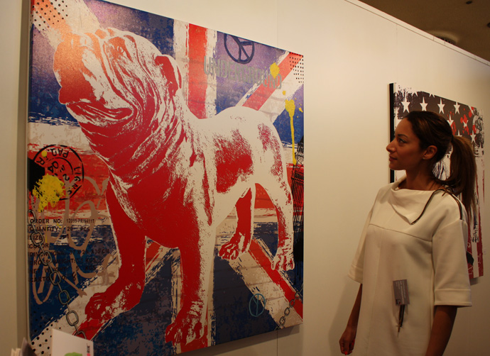 Fabienne Zehetbauer looking at her bulldog print at Art International in Zurich