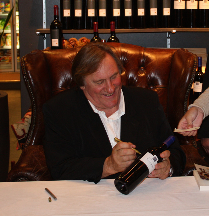 Gerard Depardieu signing a bottle of Confiance at the Globus department store in 2009