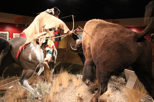 Indian killing a bison at the Bison Exhibit in Great Falls C.M. Russell Museum