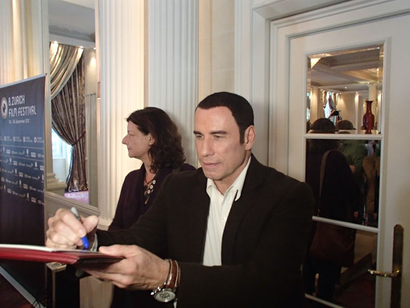 John Travolta leaving the press conference