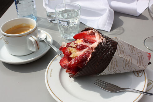 Drinking coffee and eating a strawberry choloate cone at café Landtmann