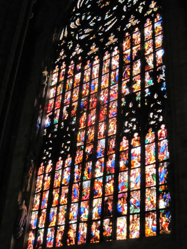 Large stain glass windows in the left transept
