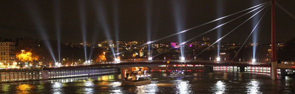 Light show over the Saone river in Lyon Festival of Lights