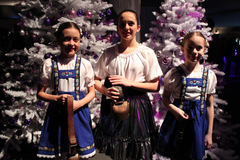 Little girls with traditional Swiss costumes and bells at Swiss Christmas