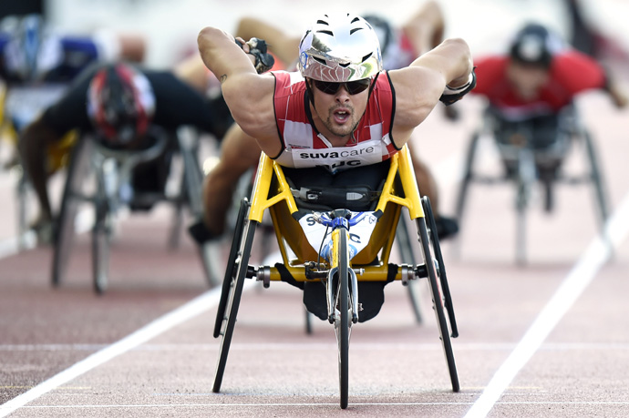 Marcel Hug from Switzerland competes in the men's wheelchair 1'500m event at the Athletissima IAAF Diamond League athletics meeting in the Stade Olympique de la Pontaise in Lausanne, Switzerland, Thursday, July 3, 2014. (KEYSTONE/Jean-Christophe Bott)