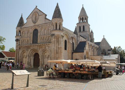 The Poitiers market square and Notre Dame la Grande church