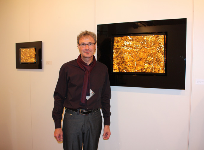 Markus Stoller with his 3D relief artworks