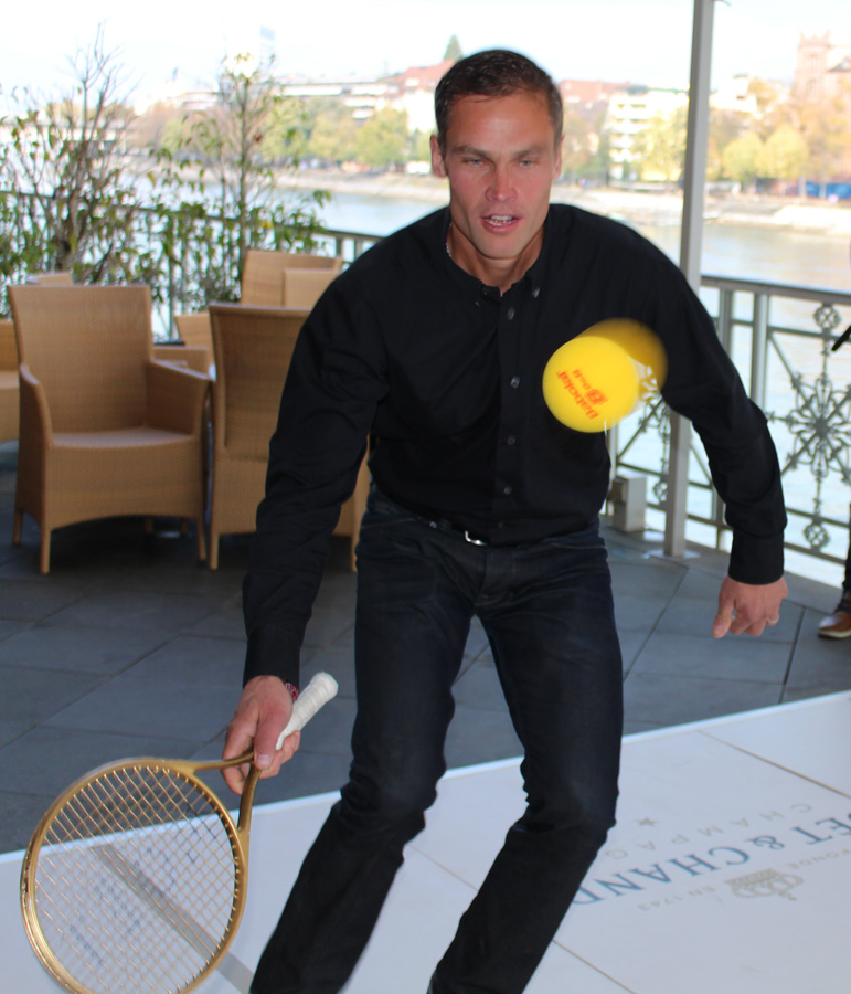 Renzo Blumenthal playing tennis at the Grand Hotel Les Trois Rois in Basel - copyright