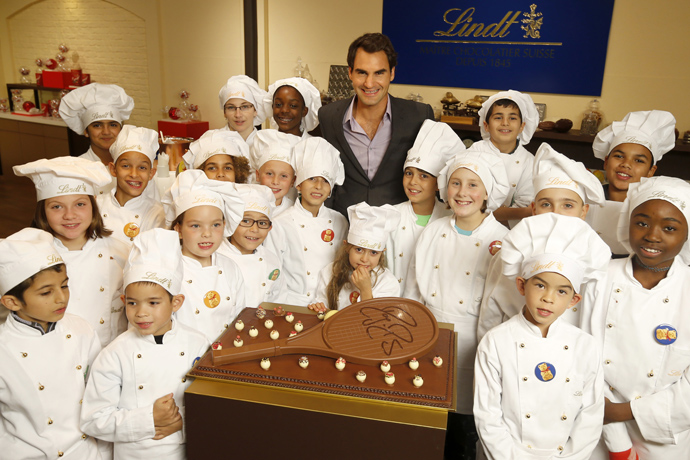 Roger Federer at Lindt in Kilchberg with children from Winterhilfe program - credit Photopress/ Alexandra Wey