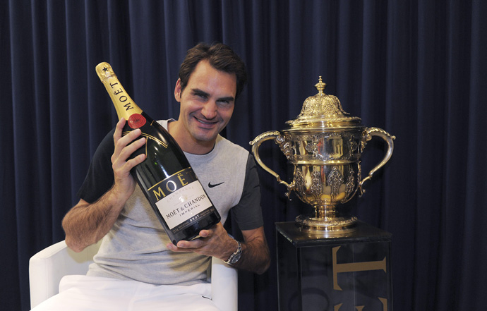 Roger Federer holds a bottle of Moet Chandon after his victory at the Swiss Indoors - copyright Moet & Chandon and Roger Federer in Basel - copyright Kurt Schorrer