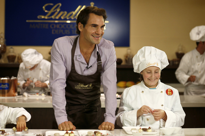Roger Federer with the children of the Winterhilfe support program at the Kilchberg chocolateria credit Photopress Alexandra Wey