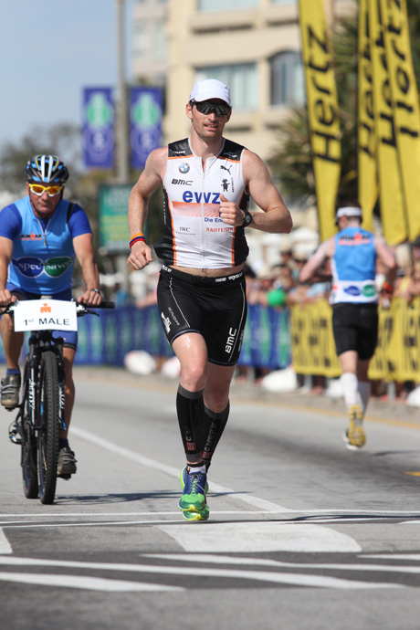 Ronnie Schildknecht running in South Africa at the Ironman - credit Craig Muller