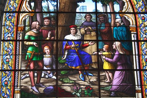 Stain glass window in Notre Dame La Grande church in Poitiers