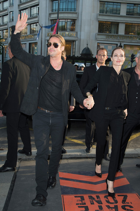 "World War Z - Paris Premiere - Red Carpet Arrivals - PARIS, FRANCE - JUNE 03:  Brad Pitt and Angelina Jolie arrive for ther Paris premiere of ""World War Z"" at Cinema UGC Normandie on June 3, 2013 in Paris, France.  (Photo by Pascal Le Segretain/Getty Images For Paramount)"