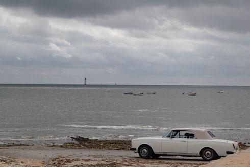 Old car on the beach in Ste Marie de Ré