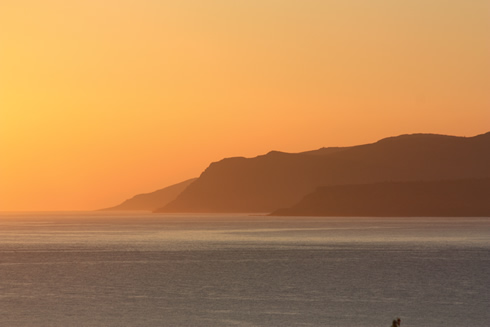 Orange sky on Malia Bay in Crete