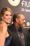 happy-nadja-schildknecht-and-laurence-fishburne-on-the-green-carpet-opening-night